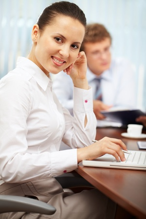 Portrait of a young businesswoman looking at camera and smiling photo
