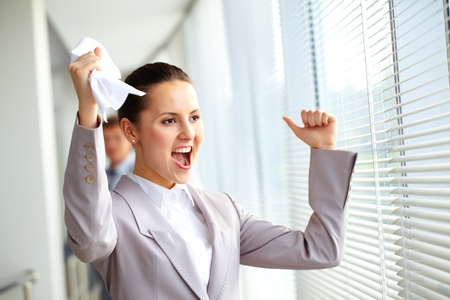 Portrait of joyful businesswoman shouting  photo