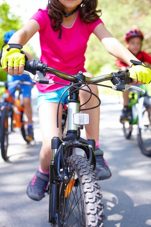 mountain bicycles: Close-up of children�s bike ridden by a girl