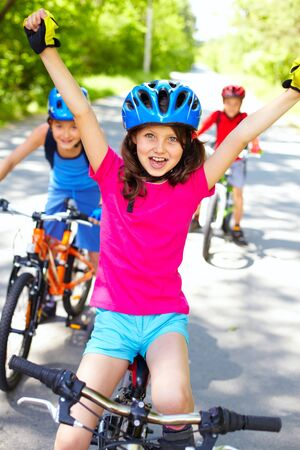 A little cyclist enjoying her victory photo