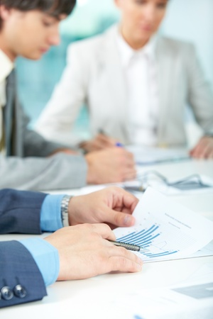 Close-up of male hands holding documents Stock Photo - 9963134