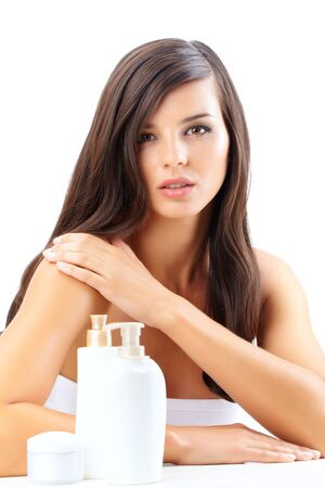 woman face cream: Portrait of a beautiful woman with cream and shower gel