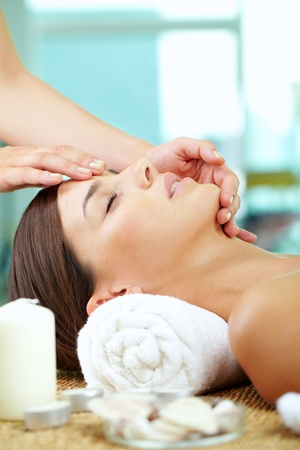 facial massage: Portrait of a woman enjoying facial Stock Photo