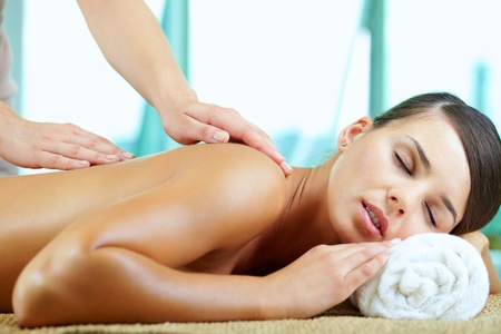 A young woman having pleasure during massage Stock Photo - 9963218