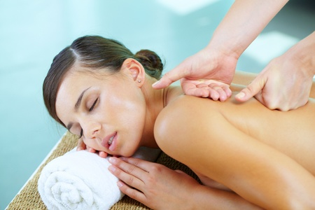 massage therapy: Portrait of a young woman during massage procedure  Stock Photo