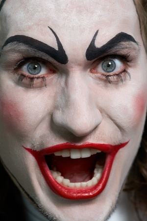 comedian: Close-up of expressive male face with theatrical makeup