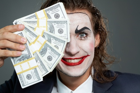 Portrait of man with painted face holding banknotes