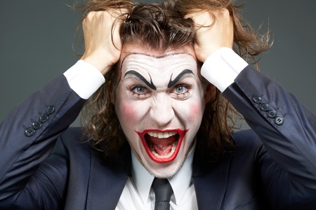 Portrait of frustrated businessman with theatrical makeup tearing hair Stock Photo - 9963234