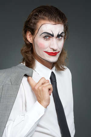 Portrait of businessman with painted face looking at camera and smiling Stock Photo - 9963163