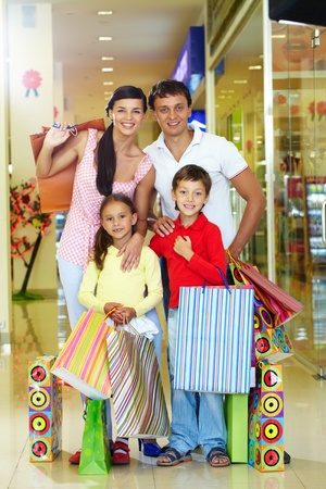 Portrait of a happy family of four in store looking at camera and smiling Stock Photo - 9963183