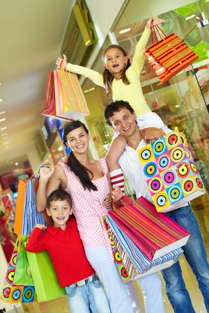 Parents with two children shopping in trade center Stock Photo - 9963184