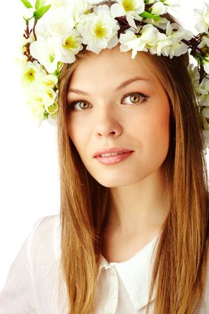Image of beautiful female wearing floral wreath on head photo
