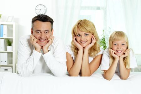 Portrait of happy parents and their daughter looking at camera at home Stock Photo - 10068515