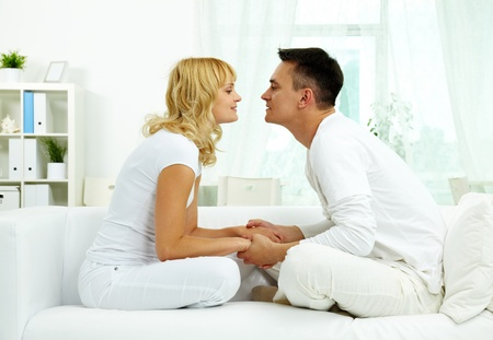 Portrait of amorous couple having rest at home Stock Photo - 10068410