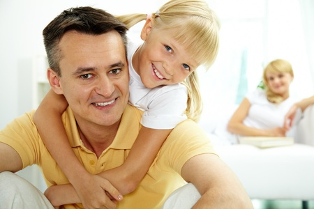 Portrait of happy father holding daughter on back and both looking at camera Stock Photo - 10068516