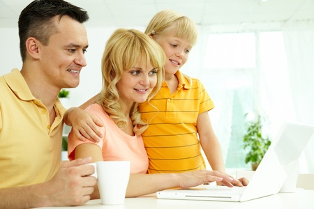 Image of friendly family using home internet   photo