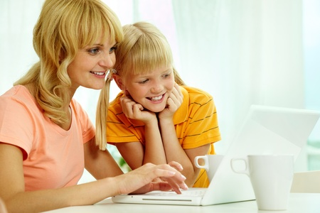 Image of happy mother and daughter using home internet   photo