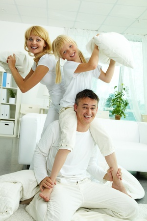 Portrait of happy parents and their daughter having fun at home  Stock Photo - 10068403