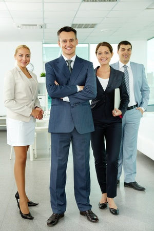 Portrait of business partners looking at camera with smiles photo