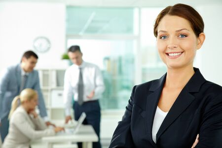 A beautiful businesswoman looking at camera in working environment Stock Photo - 10068579