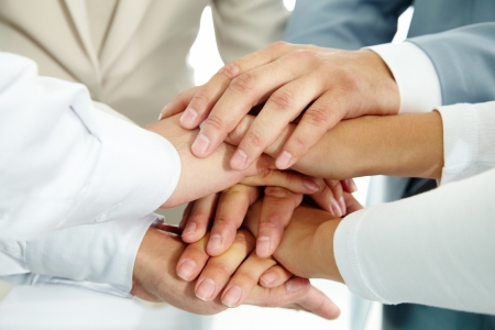 teamwork together: Image of businesspeople hands on top of each other as symbol of their partnership
