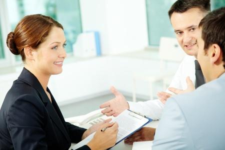 attention: Portrait of friendly professionals planning work