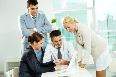 Group of business people discussing project in laptop Stock Photo - 10068587