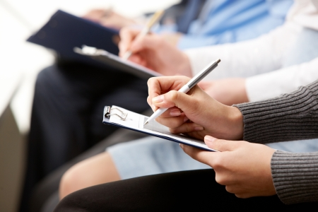 Close-up of human hands with pens over business documents Stock Photo - 10068761