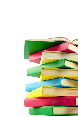 Colorful stack of books with open encyclopaedia on its top Stock Photo - 10068656