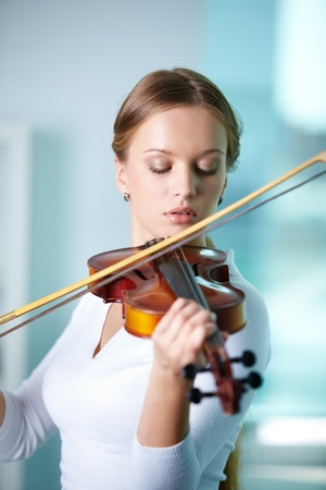 Portrait of a young female playing the violin Stock Photo - 10068915
