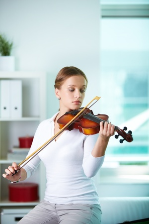 Portrait of a young female playing the violin Stock Photo - 10068868