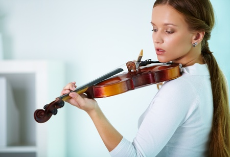 Portrait of a young female playing the violin Stock Photo - 10068865