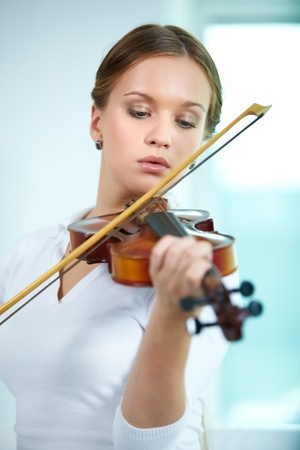 woman violin: Portrait of a young female playing the violin