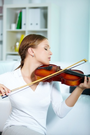 Portrait of a young female playing the violin Stock Photo - 10068864