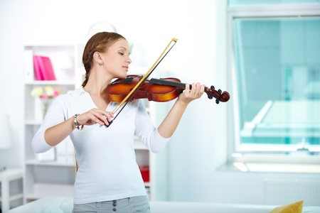 Portrait of a young female playing the violin photo