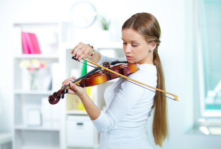 Portrait of a young female playing the violin Stock Photo - 10068811
