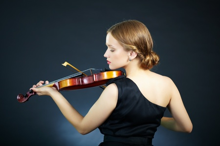 fiddlestick: Portrait of a young female playing the violin