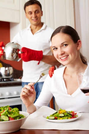 Portrait of a girl eating salad and looking at camera Stock Photo - 10068888