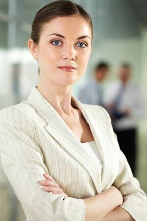 Portrait of serious businesswoman looking at camera in working environment photo