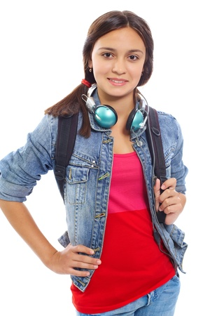 denim jacket: Cute girl with backpack and headphones smiling at camera in isolation