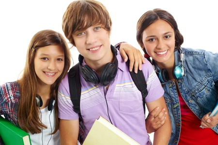 Cute teens with headphones smiling at camera photo