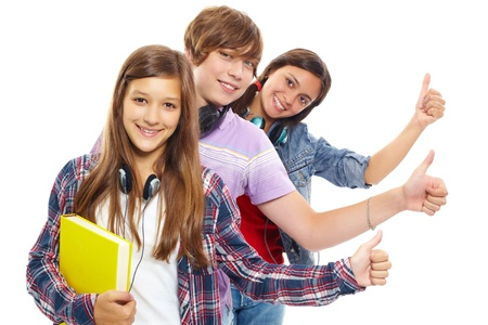 altogether: Row of teens with headphones showing thumbs up and smiling at camera Stock Photo