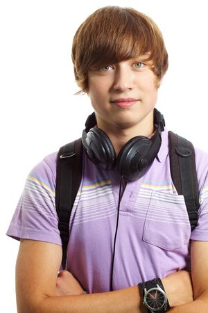 Portrait of teenage boy with headphones and backpack looking at camera Stock Photo - 10175321