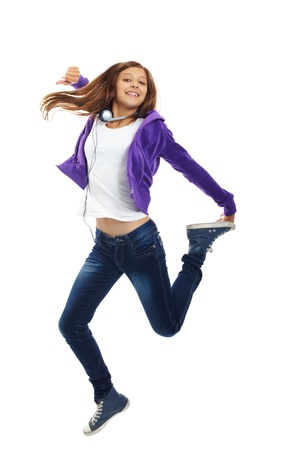 Cute girl in casual clothes jumping in isolation photo