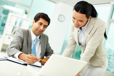 Confident businessman explaining something to colleague at meeting  photo