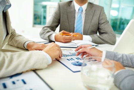 Human Resource: Image of human hands with pens over business documents at meeting Stock Photo