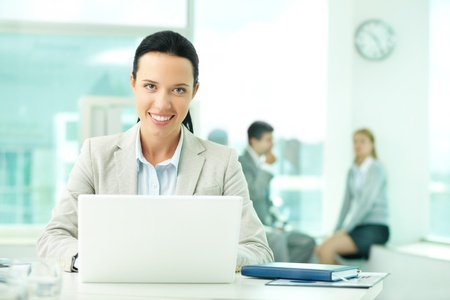 Portrait of pretty secretary looking at camera while working Stock Photo - 10203452