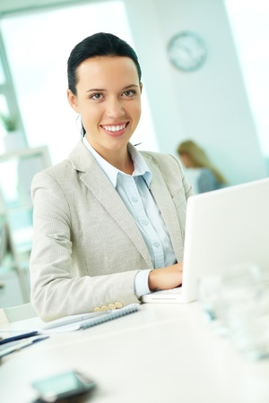 Portrait of pretty secretary looking at camera while working Stock Photo - 10203457