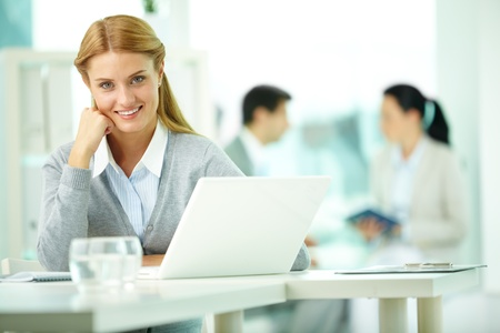Portrait of pretty secretary working with her partners on background Stock Photo - 10203453