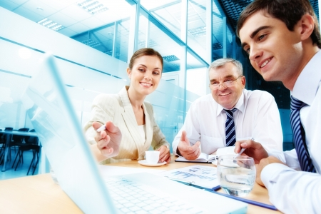 A business team of three sitting in office and planning work Stock Photo - 10203471
